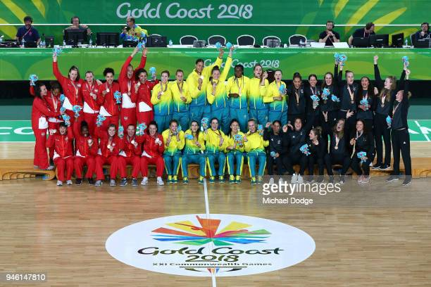 Silver medalists England gold medalists Australia and bronze medalists New Zealand pose during the medal ceremony for the Women's Gold Medal Game on...