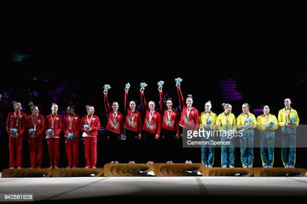 Silver medalists England, Gold medalists, Canada and bronze medalist Australia celebrate on the podium during the Women's Team Final and Individual...
