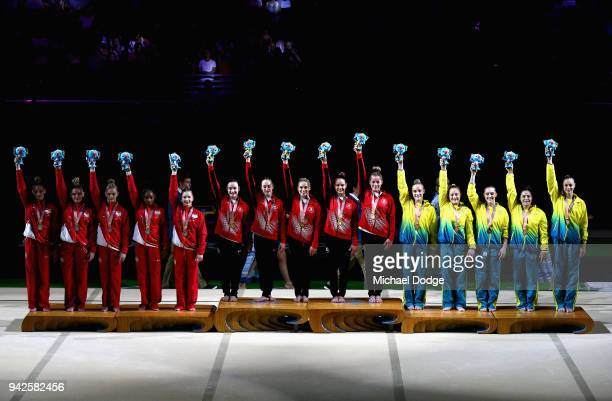 Silver medalists England Gold medalists Canada and bronze medalist Australia celebrate on the podium during the Women's Team Final and Individual...