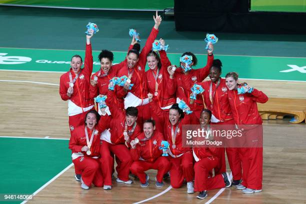 Silver medalists England pose during the medal ceremony for the Women's Gold Medal Game on day 10 of the Gold Coast 2018 Commonwealth Games at Gold...