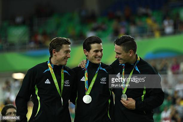 Silver medalists Ethan Mitchell Sam Webster and Edward Dawkins of New Zealand celebrate on the podium after the Men's Team Sprint Track Cycling...