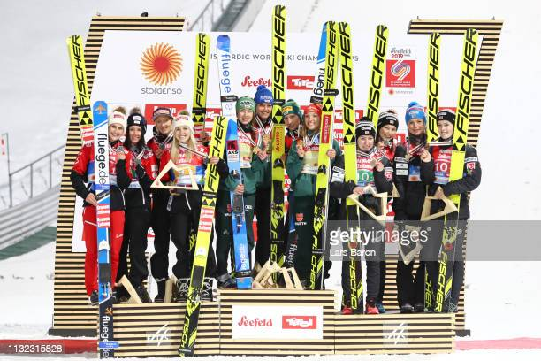 Silver medalists Eva Pinkelnig, Jacqueline Seifriedsberger, Chiara Hoelzl and Daniela Iraschko Stolz of Austria, gold medalists Katharina Althaus,...