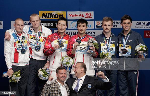Silver medalists Evgenii Kuznetsov and Ilia Zakharov of Russia gold medallists Yuan Cao and Kai Qin of China and bronze medalists Jack Laugher and...