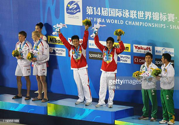 Silver medalists Evgeny Kuznetsov and Ilya Zakharov of the Russia Federation gold medalists Yutong Luo and Kai Qin of China and Julian Sanchez and...