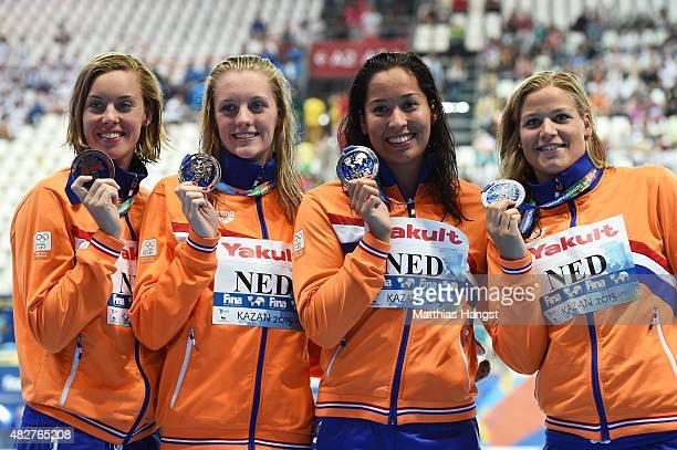 Silver medalists Femke Heemskerk Marrit Steenbergen Ranomi Kromowidjojo and Maud van der Meer of the Netherlands pose during the medal ceremony for...