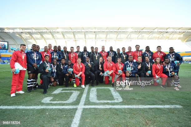 Silver medalists Fiji gold medalists New Zealand and bronze medalists England pose together during the medal ceremony for the Men's Gold Medal Rugby...