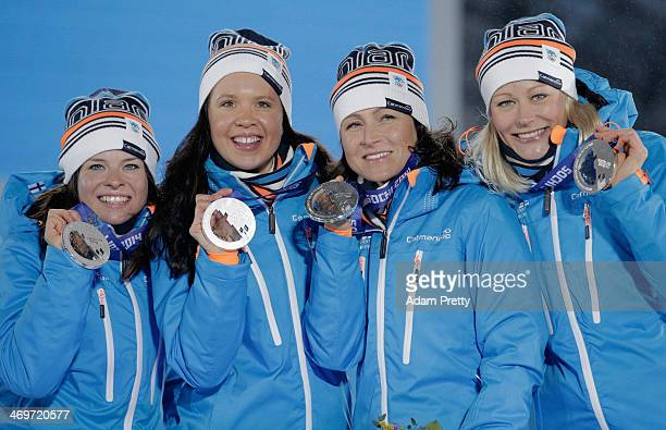 Silver medalists Finland celebrate on the podium during the medal ceremony for the Women's 4 x 5 km Relay on day 9 of the Sochi 2014 Winter Olympics...