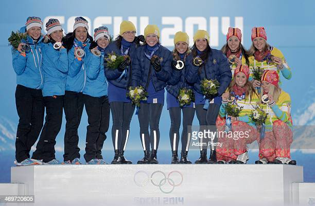 Silver medalists Finland gold medalists Sweden and bronze medalists Germany celebrate on the podium during the medal ceremony for the Women's 4 x 5...