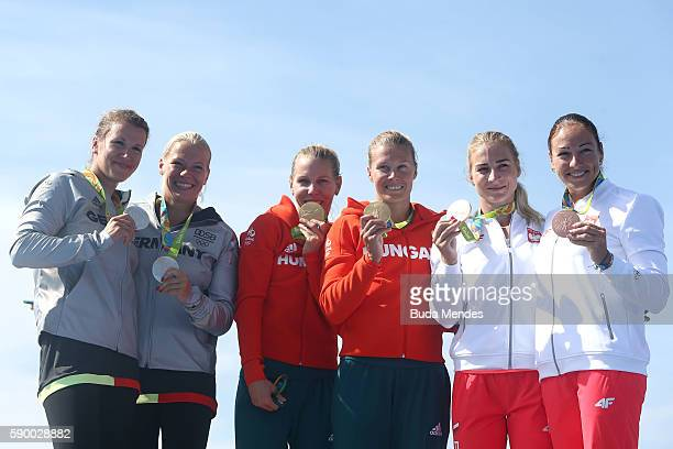 R] Silver medalists Franzi Weber and Tina Dietze of Germany gold medalists Gabriella Szabo and Danuta Kozak of Hungary and bronze medalists Karolina...