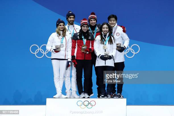 Silver medalists Gabriella Papadakis and Guillaume Cizeron of France gold medalists Tessa Virtue and Scott Moir of Canada and bronze medalists Maia...