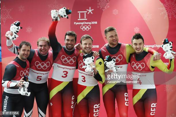 Silver medalists Georg Fischler and Peter Penz of Austria, gold medalists Tobias Wendl and Tobias Arlt of Germany and bronze medalists SToni Eggert...