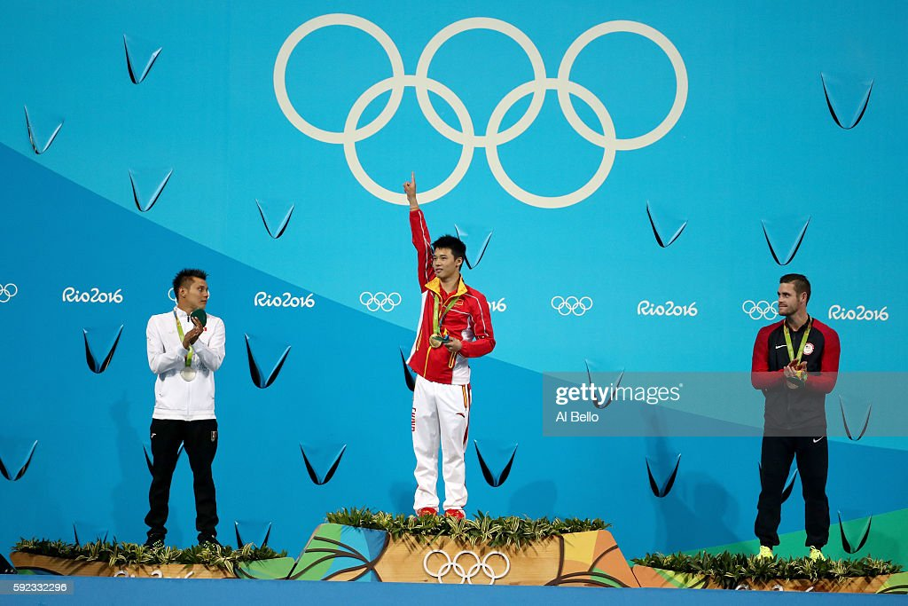 Silver medalists German Sanchez of Mexico, gold medalist Aisen Chen of China and bronze medalists David Boudia of the United States pose on the podium during the medal ceremony for the Men's Diving 10m Platform on Day 15 of the Rio 2016 Olympic Games at the Maria Lenk Aquatics Centre on August 20, 2016 in Rio de Janeiro, Brazil.