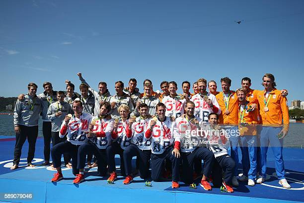 Silver medalists Germany gold medalists Great Britain and bronze medalists Netherlands pose for photographs on the podium at the medal ceremony for...