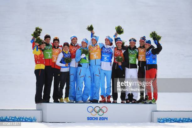 Silver medalists Germany gold medalists Norway and bronze medalists Austria celebrate during the flower ceremony for the Nordic Combined Men's Team 4...