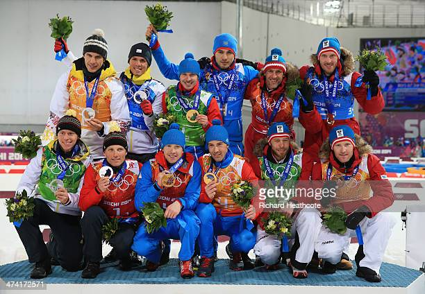 Silver medalists Germany gold medalists Russia and bronze medalists Austria pose with the medals won during the Men's 4 x 75 km Relay during day 15...