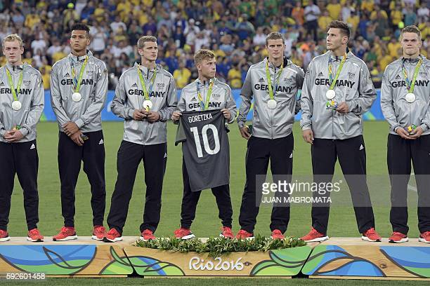 Silver Medalists Germany stand on the podium during the medal presentation following the Rio 2016 Olympic Games men's football gold medal match...