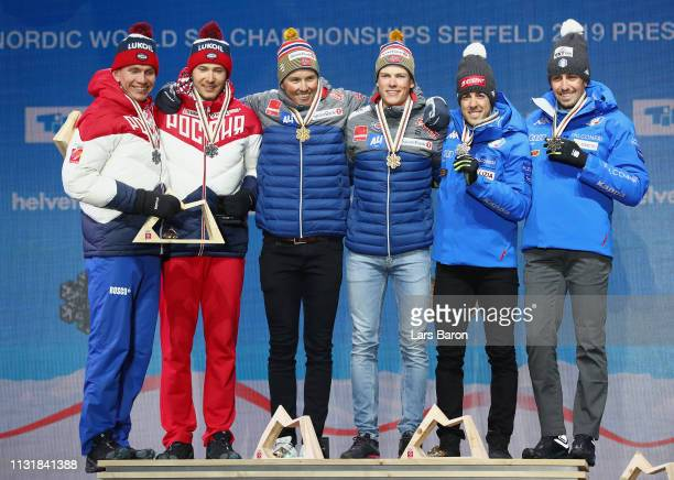Silver medalists Gleb Retivykh and Alexander Bolshunov of Russia gold medalists Johannes Hoesflot Klaebo and Emil Iversen of Norway and bronze...