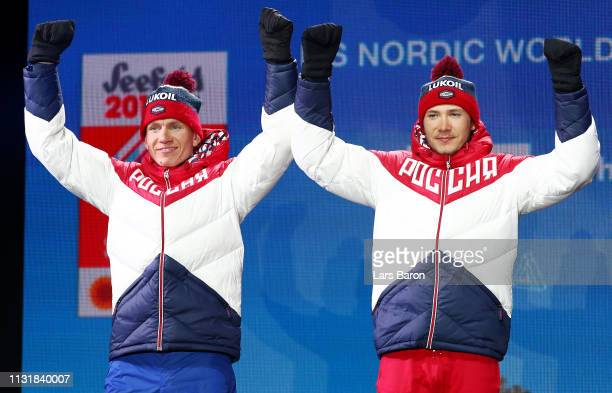 Silver medalists Gleb Retivykh of Russia and Alexander Bolshunov of Russia celebrate during the medal ceremony for the Mens' Cross Country Team...
