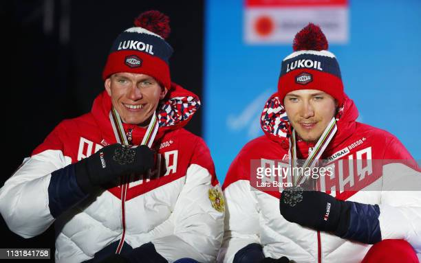 Silver medalists Gleb Retivykh of Russia and Alexander Bolshunov of Russia pose with the medals during the medal ceremony for the Mens' Cross Country...