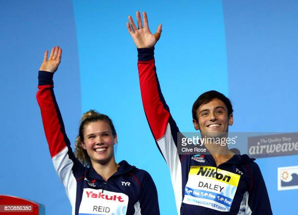 Silver medalists Grace Reid and Tom Daley of Great Britain celebrate during the medal ceremony for the Mixed 3M Synchro Springboard finalon day nine...