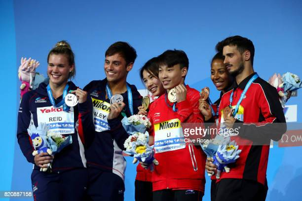 Silver medalists Grace Reid and Tom Daley of Great Britain gold medalists Han Wang and Zheng Li of China and bronze medalists Jennifer Abel and...
