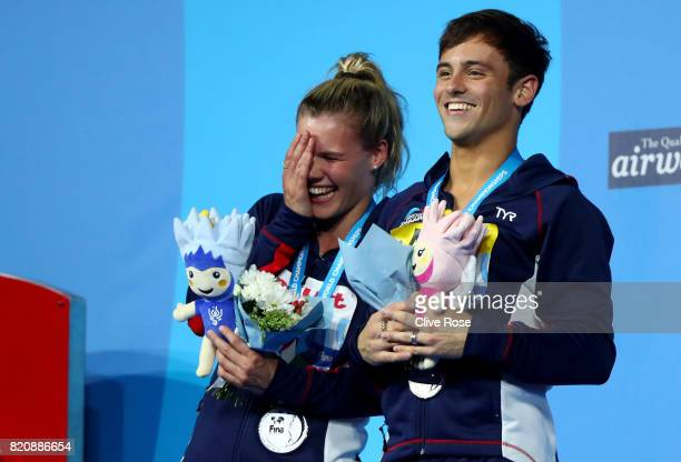 Silver medalists Grace Reid and Tom Daley of Great Britain pose with the medals won during the Mixed 3M Synchro Springboard finalon day nine of the...