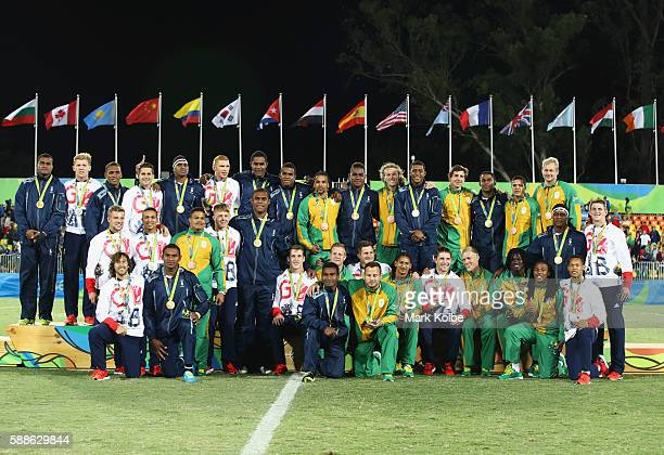 Silver medalists Great Britain gold medalists Fiji and bronze medalists South Africa pose during the medal ceremony for the Men's Rugby Sevens on Day...