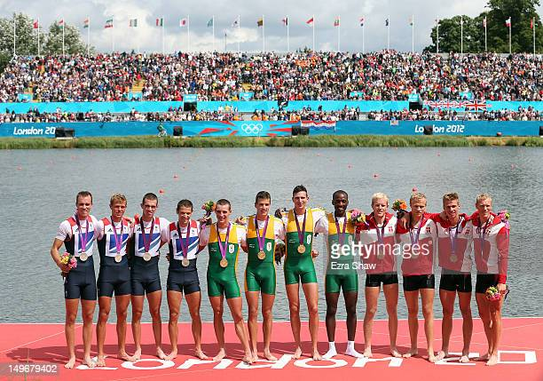 Silver medalists great Britain gold medalists South Africa and bronze medalists denmark pose with their medals during the medal ceremony for the...