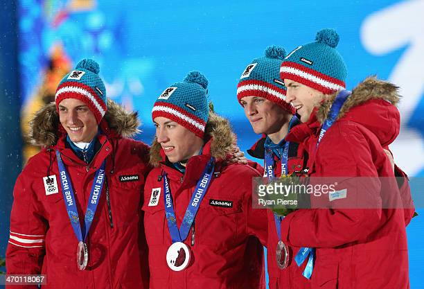 Silver medalists Gregor Schlierenzauer Thomas Diethart Thomas Morgenstern and Michael Hayboeck of Austria celebrate during the medal ceremony for the...