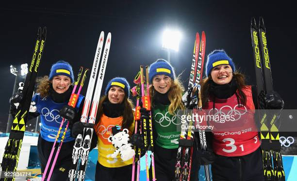 Silver medalists Hanna Oeberg Anna Magnusson Mona Brorsson and Linn Persson of Sweden celebrate after the Women's 4x6km Relay on day 13 of the...
