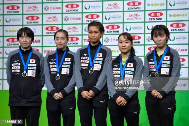 Silver medalists Head coach Mika Baba, Kasumi Ishikawa, Hitomi Sato, Mima Ito, Miu Hirano of Japan pose for photographs at the medal ceremony after...