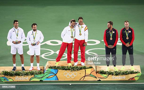 Silver medalists Horia Tecau and Florin Mergea of Romania gold medalists Rafael Nadal and Marc Lopez of Spain and bronze medalists Steve Johnson and...