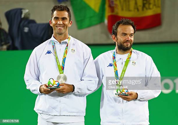 Silver medalists Horia Tecau and Florin Mergea of Romania stand on the podium after the Men's Doubles competition on Day 7 of the Rio 2016 Olympic...