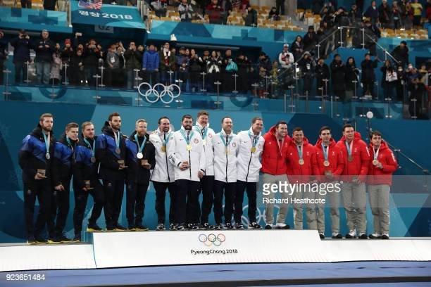 Silver medalists in Men's Curling Sweden gold medalists the United States and bronze medalists Switzerland pose for a photo during the victory...