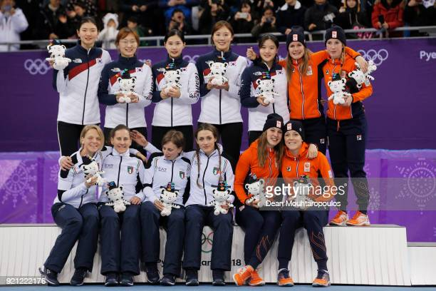 Silver medalists Italy, gold medalists South Korea and bronze medalists Netherlands pose during the medal ceremony for the Ladies Short Track Speed...