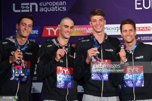 Silver medalists Italy's Luca Dotto Ivano Vendrame Lorenzo Zazzeri and Alessandro Miressi pose on the podium during the medal ceremony for the Men's...