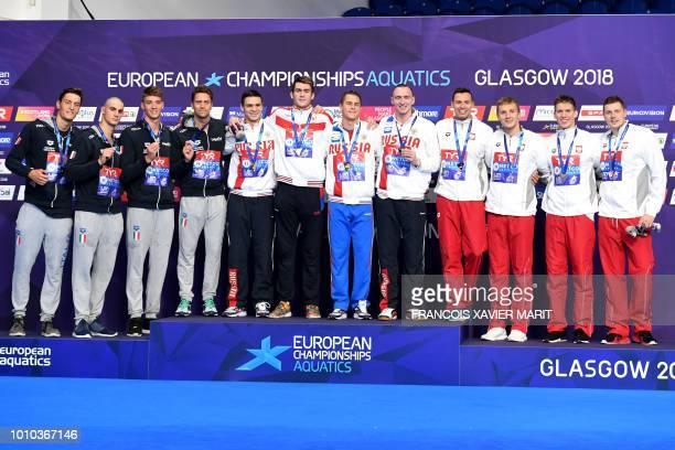 Silver medalists Italy's Luca Dotto Ivano Vendrame Lorenzo Zazzeri and Alessandro Miressi gold medalists Russia's Evgeny Rylov Danila Izotov Vladimir...