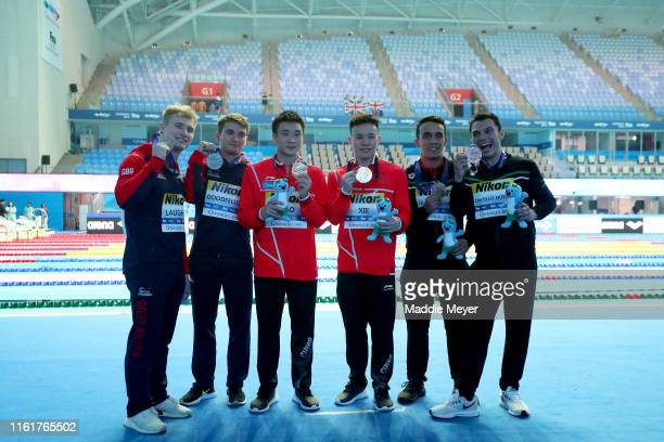 Silver medalists Jack Laugher and Daniel Goodfellow of Great Britain gold medalists Yuan Cao and Siyi Xie of China and bronze medalists and Juan...