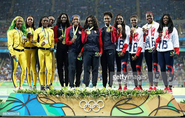 Silver medalists Jamaica gold medalists the United States and bronze medalist Great Britain stand on the podium during the medal ceremony for the...