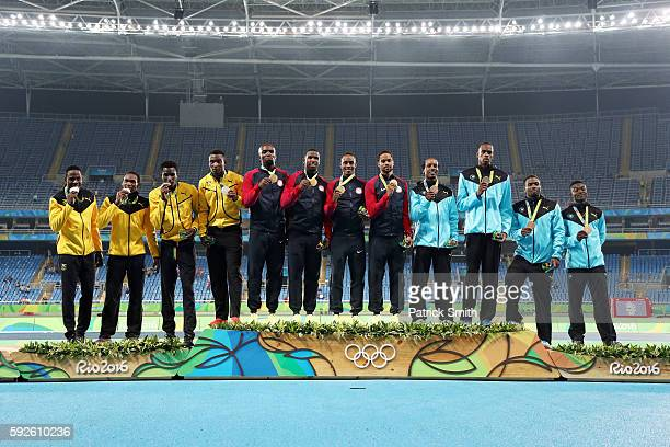 Silver medalists Jamaica gold medalists the United States and bronze medalists Bahamas stand on the podium during the medal ceremony for the Men's 4...