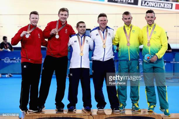 Silver medalists James Ball of Wales and pilot Peter Mitchell gold medalists Neil Fachie of Scotland and pilot Matt Rotherham and bronze medalists...