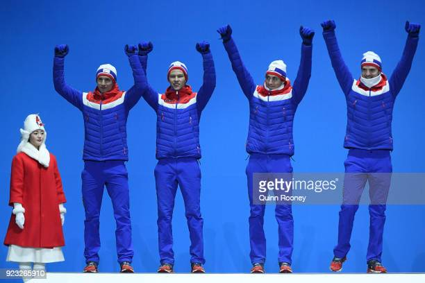 Silver medalists Jan Schmid Espen Andersen Jarl Magnus Riiber and Joergen Graabak of Norway celebrate during the medal ceremony for Nordic Combined...