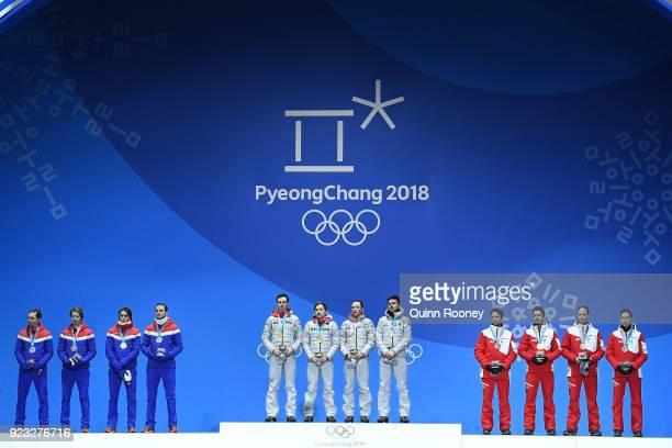 Silver medalists Jan Schmid, Espen Andersen, Jarl Magnus Riiber and Joergen Graabak of Norway, gold medalists Vinzenz Geiger, Fabian Riessle, Eric...