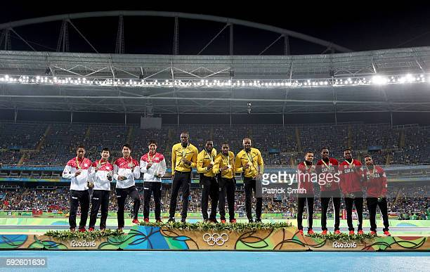 Silver medalists Japan, gold medalists Jamaica and bronze medalists Canada stand on the podium during the medal ceremony for the Men's 4 x 100 meter...