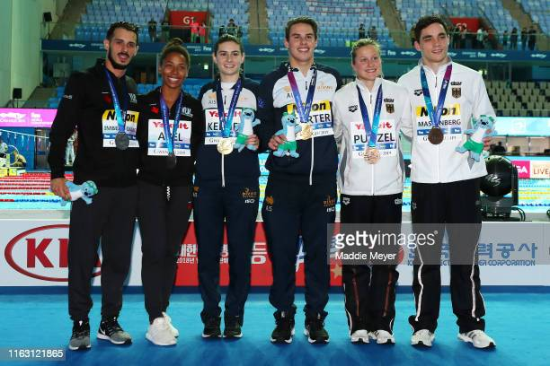 Silver medalists Jennifer Abel and Francois ImbeauDulac of Canada gold medalists Maddison Keeney and Matthew Carter of Australia and bronze medalists...