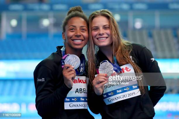 Silver medalists Jennifer Abel and Melissa Citrini Beaulieu of Canada pose during the medal ceremony for the Women's 3m Synchro Springboard Final on...