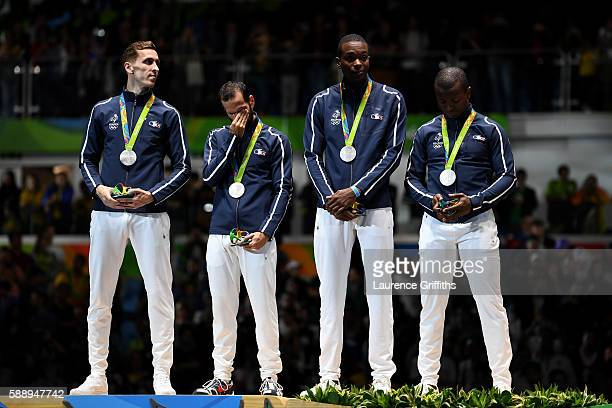 Silver medalists Jeremy Cadot Erwan le Pechoux Lefort Enzo and JeanPaul Tony Helisssey of France celebrate on the podium for the Men's Team Foil...