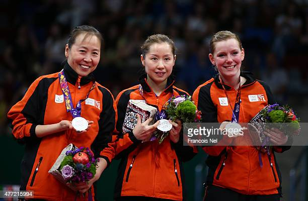 Silver medalists Jiao Li Jie Li and Britt Eerland of Netherlands pose with the medals won in the Women's Team Table Tennis finals during day three of...