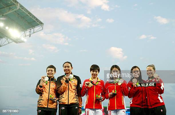 Silver medalists Jun Hoong Cheong and Pandelela Rinong of Malaysia gold medalists Ruolin Chen and Huixia Liu of China and bronze medalists Meaghan...