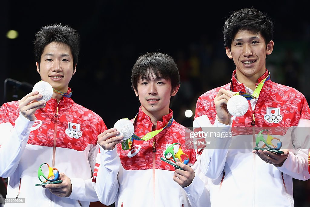 Silver medalists Jun Mizutani, Maharu Yoshimura and Koki Niwa of Japan celebrate during the medal ceremony after the Men's Team Table Tennis gold match against China on Day 12 of the Rio 2016 Olympic Games at Riocentro - Pavilion 3 on August 17, 2016 in Rio de Janeiro, Brazil.